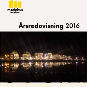 Omslag till årsredovisningen, kvällsbild över bostadsområdet Ekudden